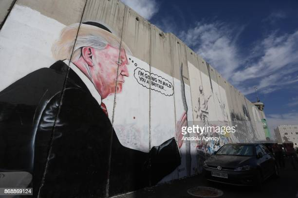 Graffiti art is seen on Israeli separation wall in the West Bank town of Bethlehem on November 01 2017