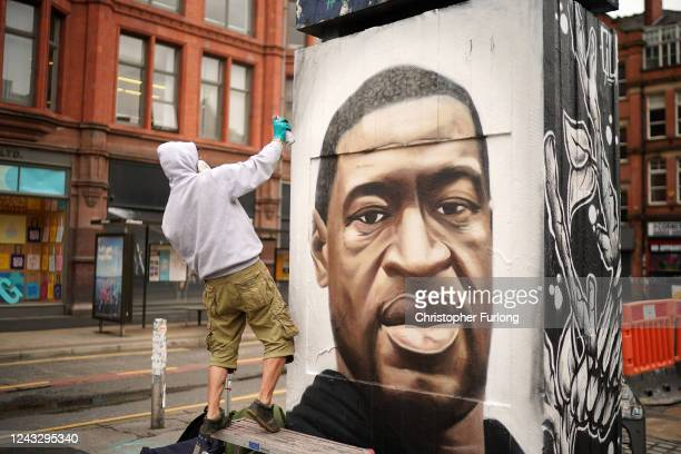 Graffiti artist Akse spray paints a mural of George Floyd in Manchester's northern quarter on June 03 2020 in Manchester United Kingdom The death of...