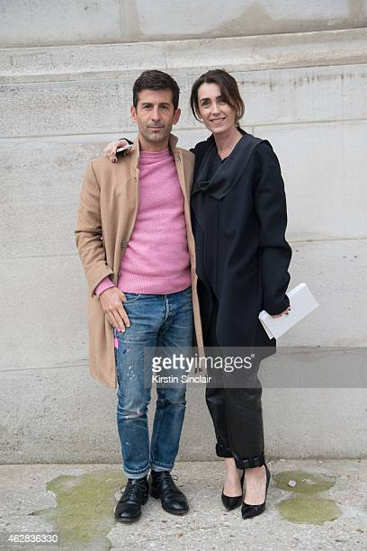 Graffiti artist Andre aka Andre Saraiva and A guest day 3 of Paris Haute Couture Fashion Week Spring/Summer 2015 on January 27 2015 in Paris France