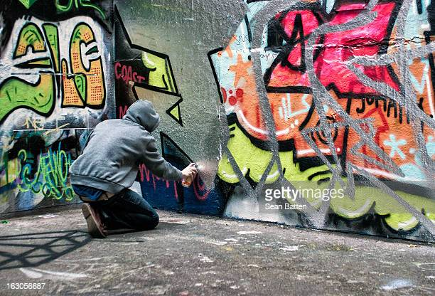 CONTENT] A graffiti artist at work near the Southbank Center in London In this sectioned off area people are allow to BMX skateboard and spray...