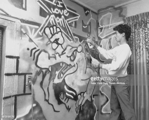Graffiti artist Atom paints mural on bedroom wall