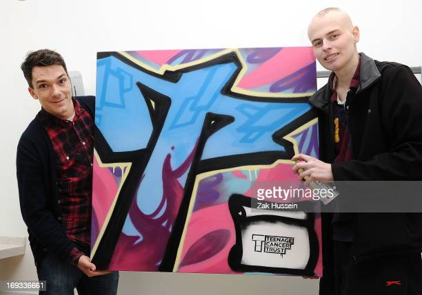 Graffiti artist Ben McKay and cancer patient Alex Gaunt, 18 from Caterham celebrate the first birthday of Teenage Cancer Unit by creating a special...