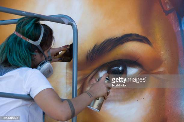 Graffiti artist Clara Leff from Brazil finishing her art mural at the Miami Open Leff was commissioned by Bank Itau the main sponsor of the...