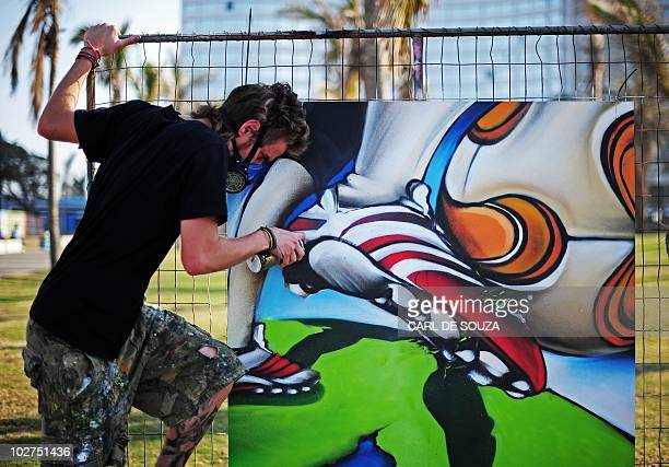A graffiti artist creates a picture of South African icon Nelson Mandela as he competes in a graffiti competition in Durban South Africa on July 9...