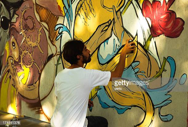 graffiti artist is working - street artist stock photos and pictures