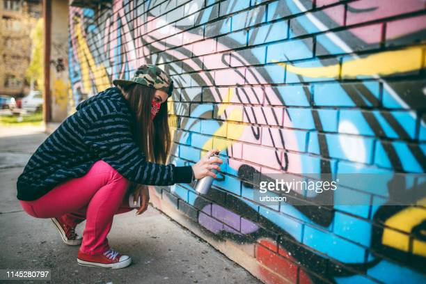 graffiti artist painting - street artist stock photos and pictures