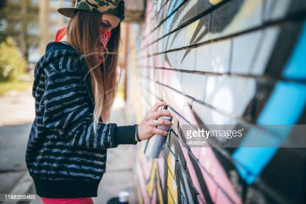graffiti artist painting - street artist stock pictures, royalty-free photos & images