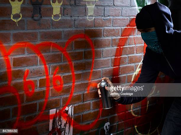 graffiti artist painting - vandalism stock pictures, royalty-free photos & images