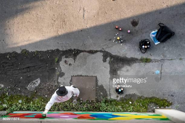 Graffiti Artist Spraying on the Wall