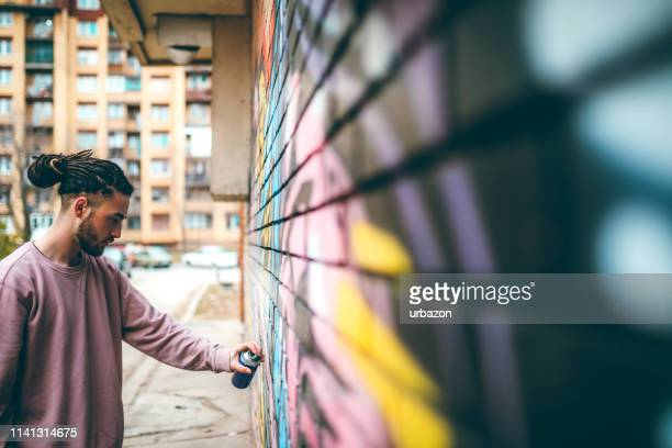 graffiti artist with dreadlocks - street artist stock pictures, royalty-free photos & images