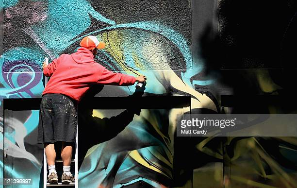 A graffiti artist works on what is set to be the UK's largest street art project on August 19 2011 in Bristol England The See No Evil art project on...