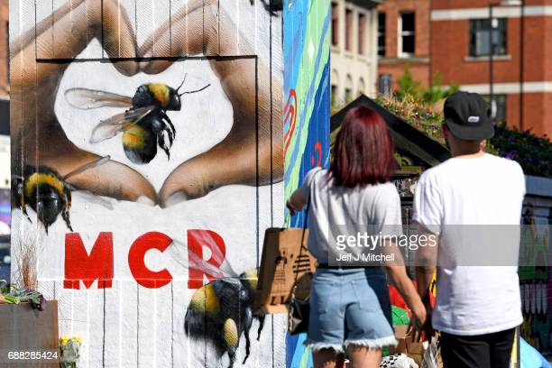 Graffiti artists paint murals in Stevenson Square following the wake of Monday's terror attack at the Manchester Arena attack on May 25 2017 in...