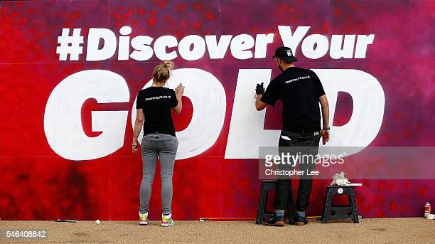 Graffiti Artists paint the hashtag #DiscoverYourGold during the launch of the Discover Your Gold at Lee Valley Velopark Velodrome on July 12, 2016 in...