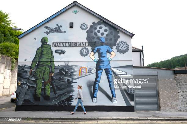 Graffiti artwork created by Tom Llewellyn who goes under the name tee2 sugars showing a solider and a nurse on the side of the Wayne Morgan Club on...