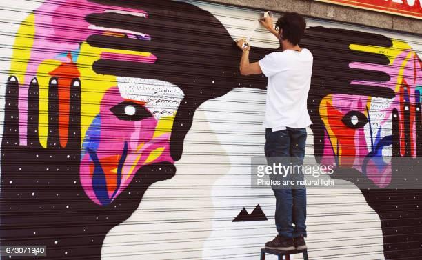 Graffiti boy,working in the street