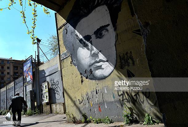 A graffiti by Italian artist Ozmo depicting Italian writer Antonio Gramsci covers a wall in Rome on March 31 2014 CAPTION