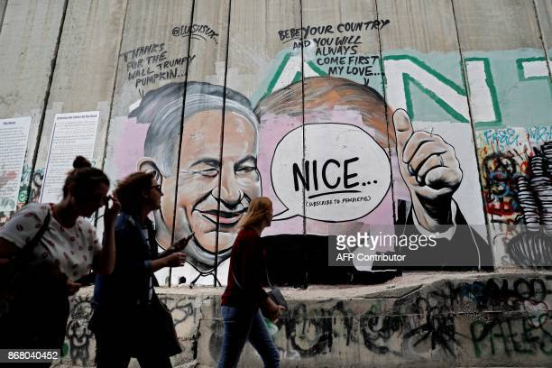 Graffiti by street artist Lushsux, that originally depicted US President Donald Trump kissing Israeli Prime Minister Benjamin Netanyahu, is seen...