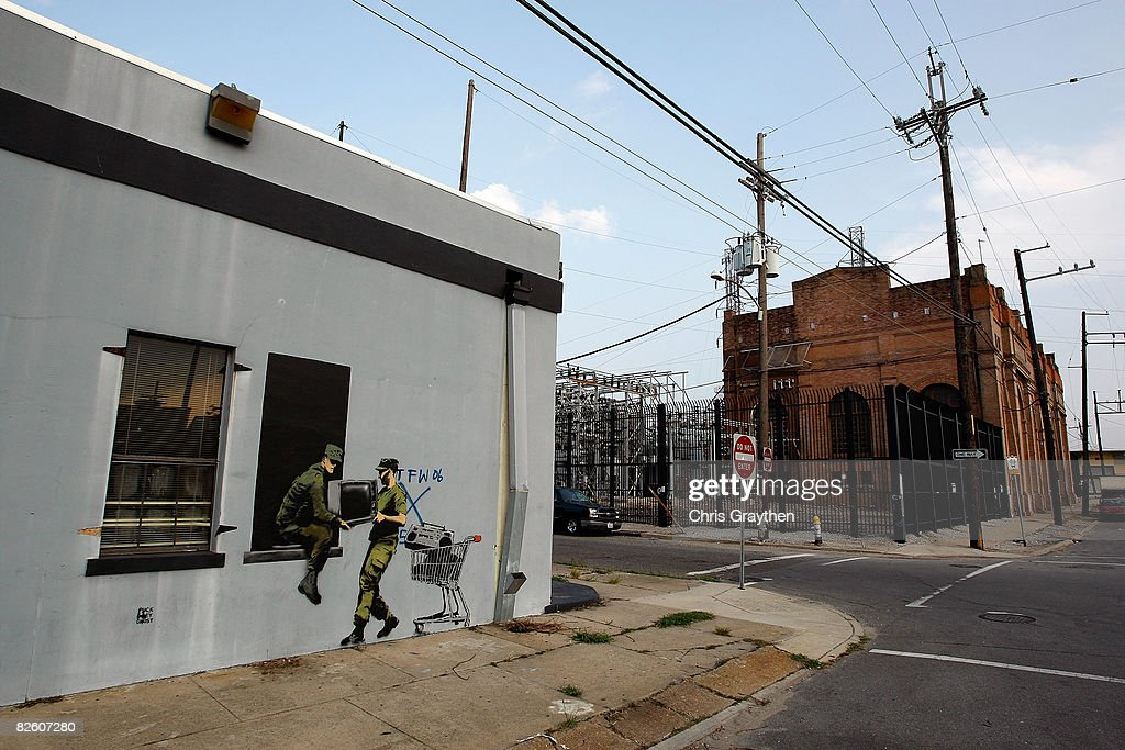 Banksy Graffiti Murals Pop Up Around New Orleans, Including Levee Wall : News Photo