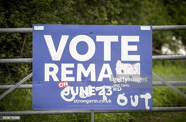 Graffiti calling for an out vote adorns a poster calling support for a vote to remain in the European Union in the referendum being held on June 23...