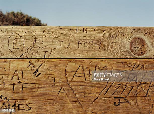 Graffiti carved in wood