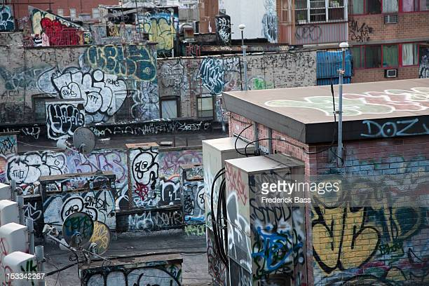 Graffiti covered tenement rooftop in Chinatown