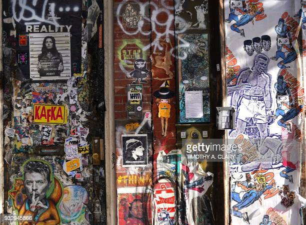 A graffiti covered wall outside the Overthrow Boxing Club in the east village of New York March 16 2018 Overthrow Boxing is a nofrills boxing workout...