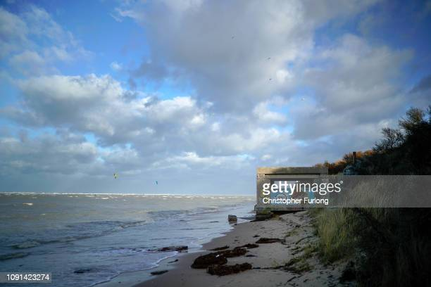 Graffiti covered WWII bunkers lay on the beach at OyePlage where it is believed that migrants could launch boats to cross the English Channel on...