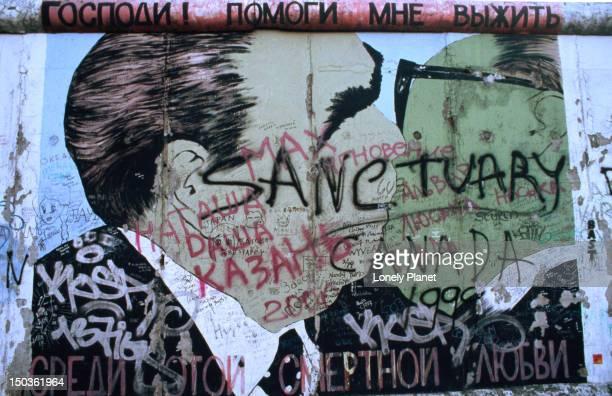 Graffiti covering painting of Brezhnev kissing Honecker, East Side Gallery of former Berlin Wall, Friedrichshain.
