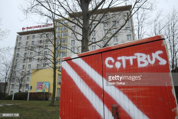 Graffiti covers an electric switching box outside an office building that includes charities that advise refugees on January 23 2018 in Cottbus...