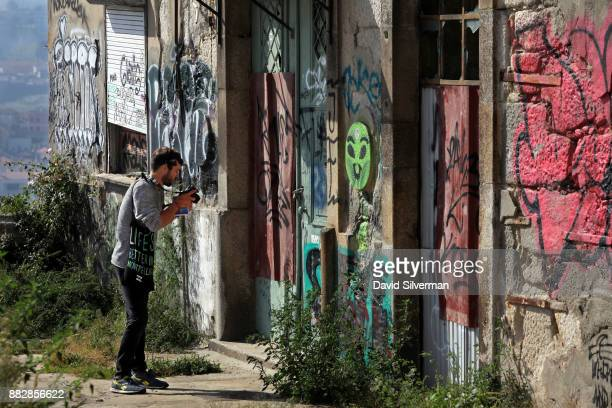 Graffiti covers the walls of an abandoned building in the city center on October 6 2016 in Porto in northern Portugal Porto is the country's...