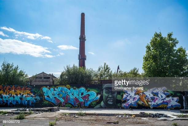 Graffiti covers walls and fences near the derelict Great Northern Railway Bonded Warehouse on May 31 2017 in Derby England The Derby North...