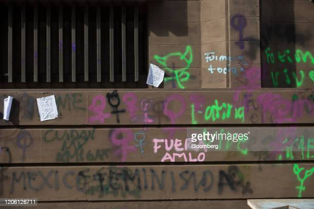 Graffiti deface a wall during a rally on International Women's Day in Mexico City Mexico on Friday March 8 2020 The United Nations first recognized...