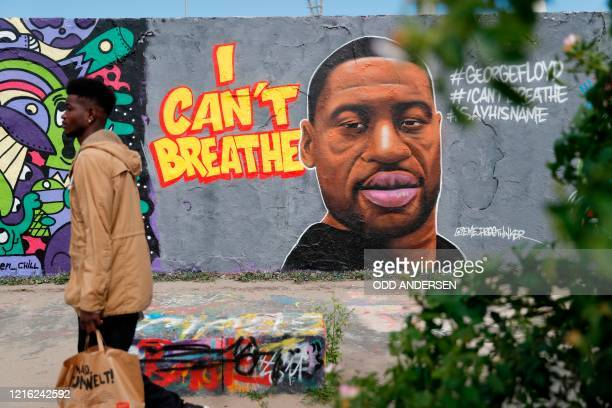 TOPSHOT A graffiti depicting a portrait of George Floyd a black man who died in Minneapolis after a white policeman kneeled on his neck for several...