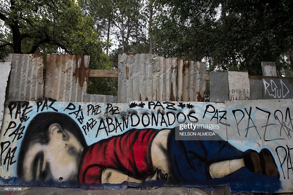 A graffiti depicting Aylan Kurdi, also known as Aylan Shenu, a Syrian three-year-old boy whose drowning off a Turkish beach, is seen in Sorocaba, some 90 km from Sao Paulo, Brazil, on September 6, 2015.