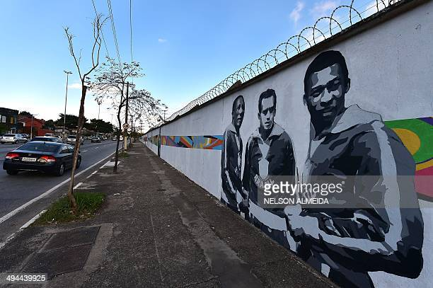 A graffiti depicting Brazilian football legend Pele painted by Brazilian street artist Paulo Consentino in celebration of the FIFA 2014 World Cup is...