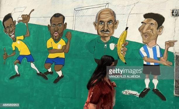 Graffiti depicting Brazil's national team footballers : Neymar, Daniel Alves, coach Luiz Felipe Scolari and Argentina's team Lionel Messi, in a...