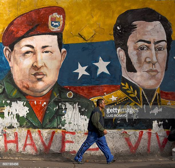 Graffiti depicting late Venezuelan president Hugo Chavez and XIX Cetury hero Simon Bolivar on a wall in the vivinity of a polling station in the...