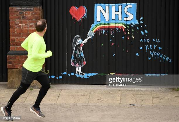 Graffiti depicting the logo of Britain's National Health Service and a rainbow, in an outpouring of love and thanks to NHS staff and key workers...