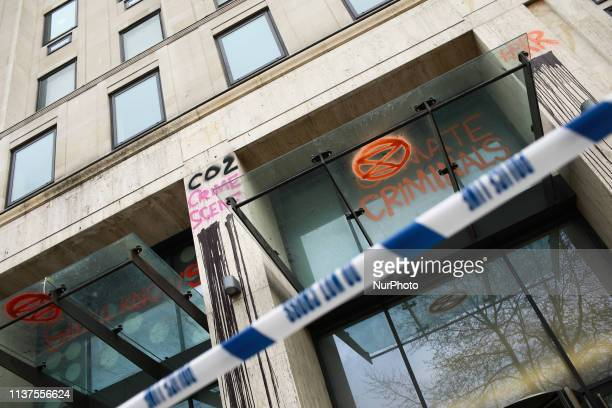 Graffiti drawn by members and supporters of climate change activist group Extinction Rebellion covers the offices of oil company Shell in London...