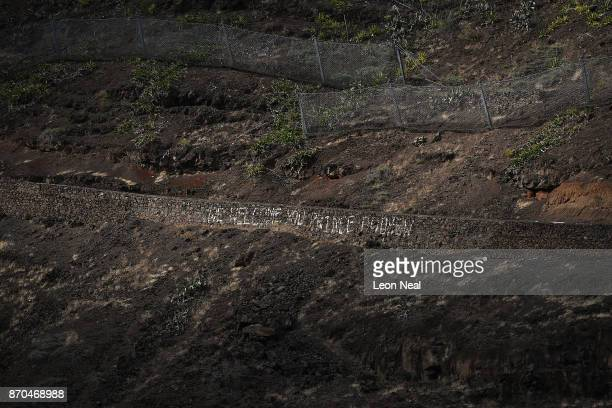 Graffiti from Britain's Prince Andrew's visit in 1984 is seen in a pool of sunlight on October 26 2017 in Jamestown Saint Helena Following the...