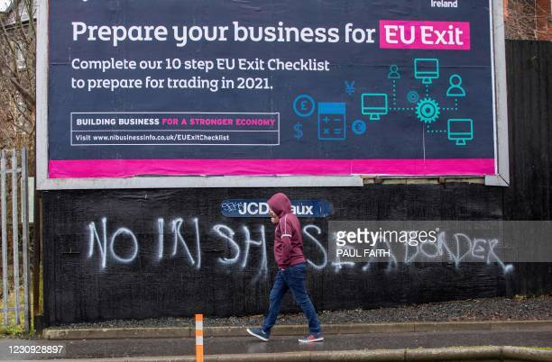 Graffiti in a loyalist area of south Belfast against an Irish sea border is seen on February 2, 2021. - The British government today condemned...
