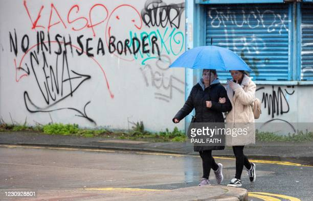 Graffiti in a loyalist area of south Belfast, Northern Ireland against an Irish sea border is seen on February 2, 2021. - The British government...