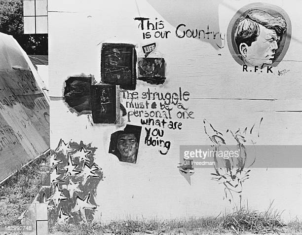 Graffiti including a painting of Robert Kennedy and a collage of pages taken from 'Life' magazine on a shelter in Resurrection City a three thousand...