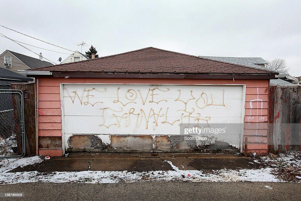 Graffiti is painted on a garage near the spot where Federico Martinez was gunned down two days ago on December 28, 2012 in Chicago, Illinois. Martinez was believed to be the 499th murder victim of the year in Chicago when he was killed on December 26. After news organizations began reporting about the city's 500th murder victim, the Chicago Police Department's News Affairs Office issued a statement stating Chicago's murder total remains at 499 because classification of one death investigation remains pending. They would not specify which death is pending. The total number of murders in the city has only once exceeded 500 victims since 2004. The murder rate is up about 11 percent from 2011, much of which is attributed to growing gang violence.