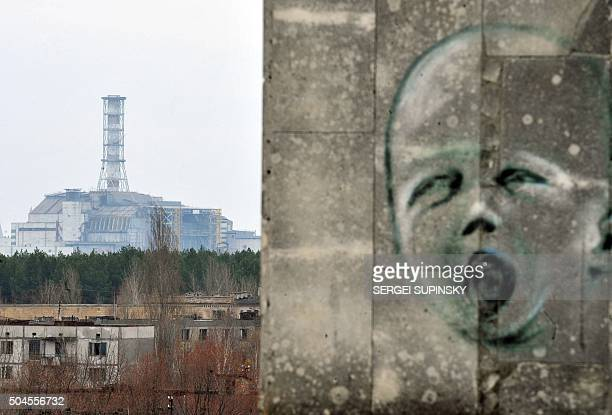Graffiti is pictured on a wall in the ghost city of Pripyat near the fourth nuclear reactor at the former Chernobyl Nuclear power plant, site of the...