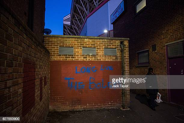 Graffiti is pictured on a wall outside the Boleyn Ground in Upton Park on December 3 2016 in London England West Ham United played Arsenal in a...