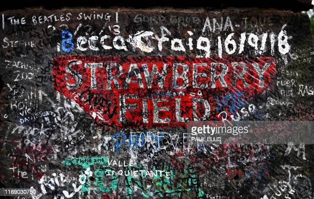 TOPSHOT Graffiti is pictured on the gates to Strawberry Field in Liverpool northwest England on September 18 2019 Beatles fans can now take a trip...