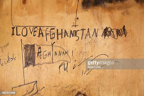 Graffiti is scribbled on the wall of an abandoned dining facility which is in an area on Forward Operating Base Shank that is no longer used due to a...