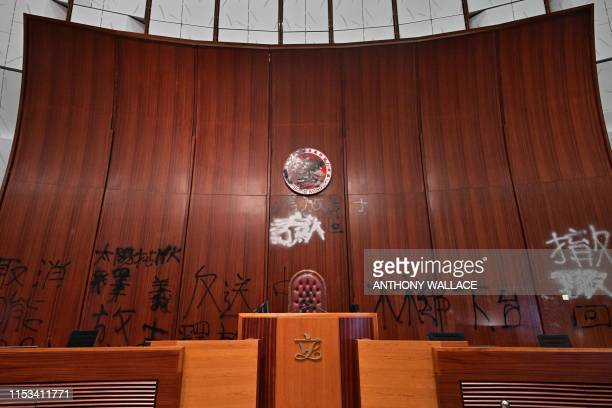 TOPSHOT Graffiti is seen behind the speakers chair in the main chamber of the Legislative Council during a media tour in Hong Kong on July 3 two days...
