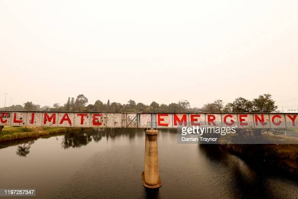 Graffiti is seen on a bridge on January 03 2020 in Bairnsdale Australia The HMAS Choules docked outside of Mallacoota this morning to evacuate...